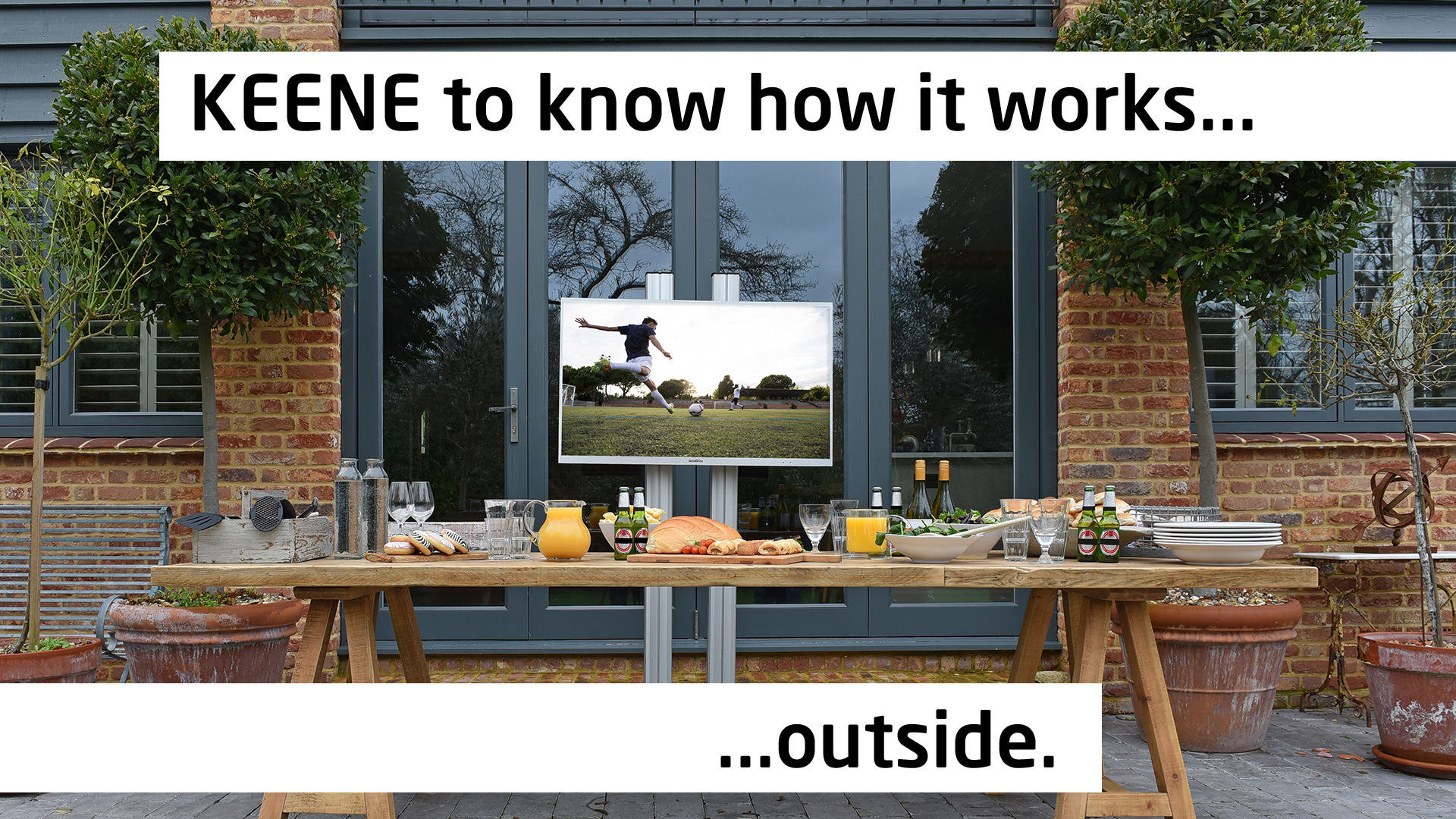 Proofvision Waterproof TV outside with a dining table in front